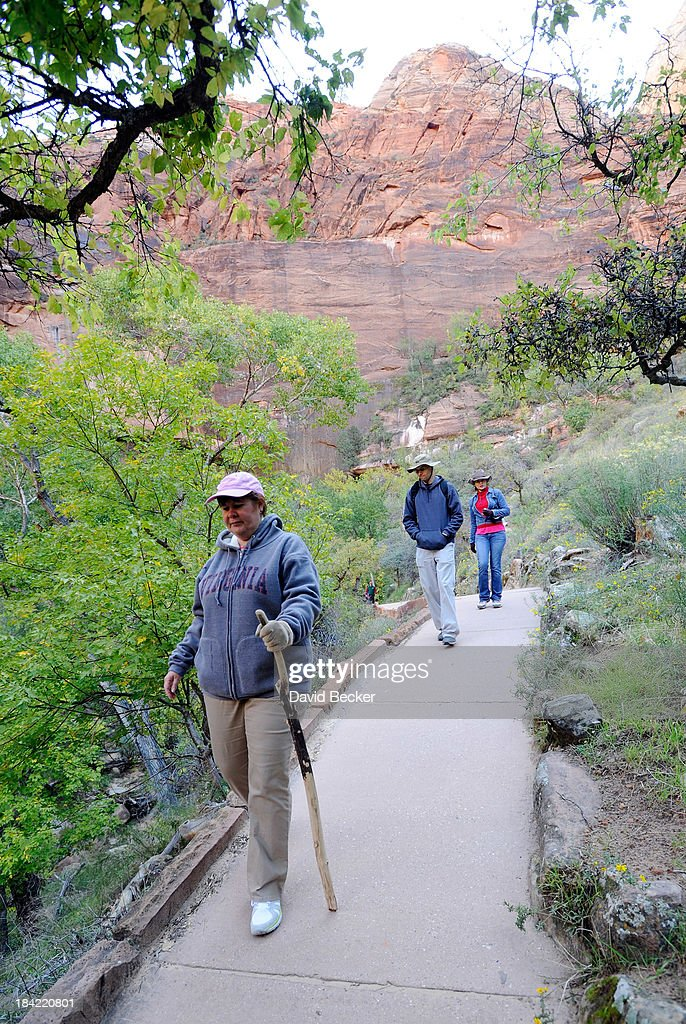 Park visitors hike the Weeping Rock trail inside Zion National Park on October 12, 2013 in Springdale, Utah. The Obama administration said it would allow states to use their own money to reopen some national parks after a handful of governors made the request. Utah Gov. Gary Herbert said he reached an agreement to pay $166,572 a day to the Interior Department to open eight national sites in Utah.