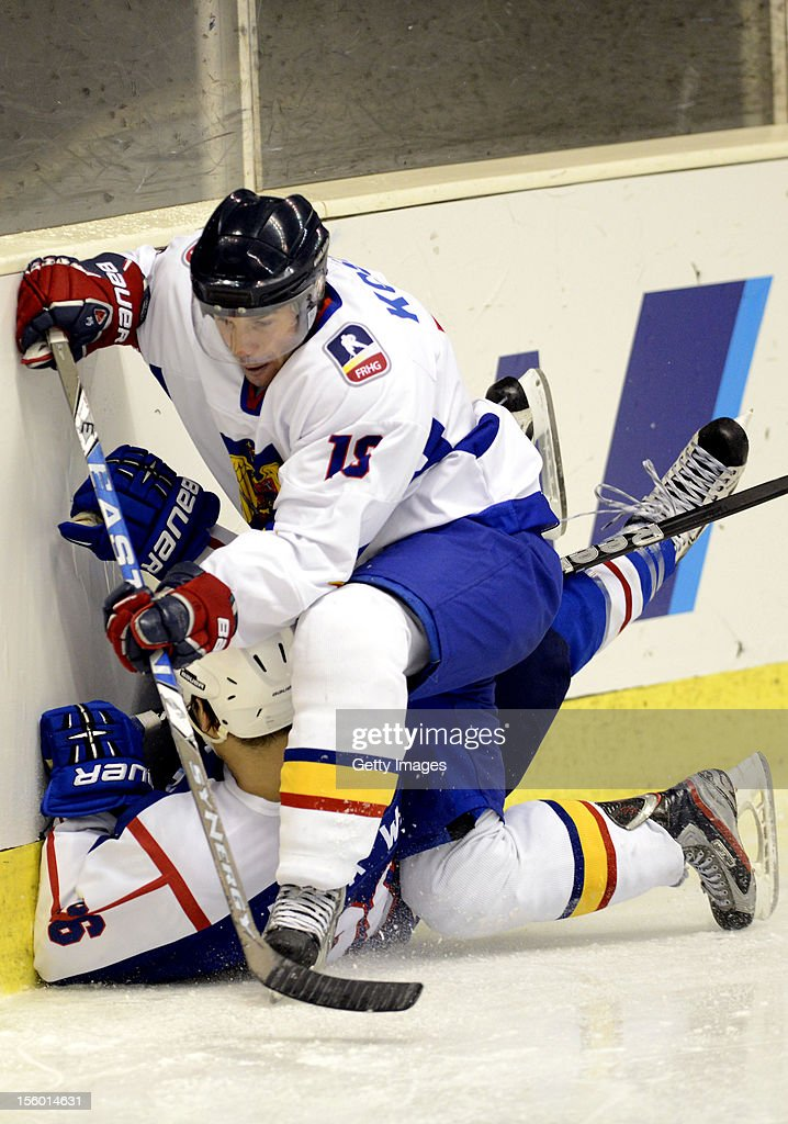 Park Woosang #26 of South Korea is defended by Endre Kosa #18 of Romania during the Ice Hockey Sochi Olympic Pre-Qualification Group J match between South Korea and Romania at Nikko Kirifuri Ice Arena on November 11, 2012 in Nikko, Tochigi, Japan. South Korea won 2-0.