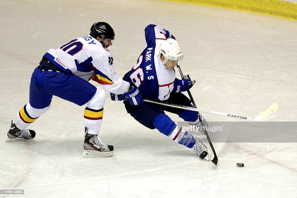 Park Woosang #26 of South Korea skates against Csaba Nagy #10 of Romania during the Ice Hockey Sochi Olympic Pre-Qualification Group J match between South Korea and Romania at Nikko Kirifuri Ice Arena on November 11, 2012 in Nikko, Tochigi, Japan. South Korea won 2-0.