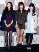 Park YeLyn YuBin of Wondergirls and Park JiMin attend Sun's Wedding at lotte hotel on January 26 2013 in Seoul South Korea