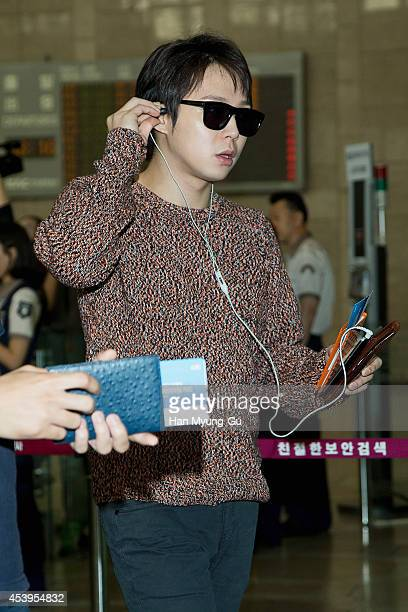 Park YooChun of South Korean boy band JYJ is seen on departure at the Gimpo International Airport on August 22 2014 in Seoul South Korea