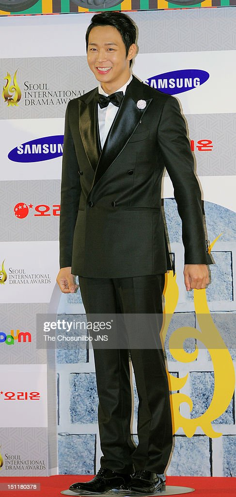 Park Yoo-Chun poses for photographs upon arrival during 'Seoul International Drama Awards 2012' at the National Theater of Korea on August 30, 2012 in Seoul, South Korea.