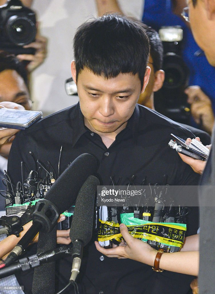 Park Yu Chun, a member of popular K-pop boy band JYJ, speaks to reporters at a police station in southern Seoul on June 30, 2016, as he enters there to face questioning over sexual assault allegations.