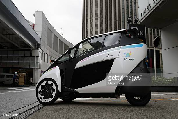 A park24 Co employee driving a Toyota Motor Corp iROAD electric personal mobility vehicle leaves a parking lot in Tokyo Japan on Wednesday April 22...