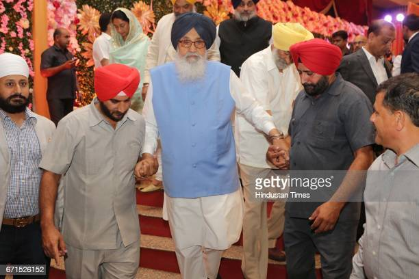 Parkash Singh Badal during the wedding reception of INLD MP Dushyant Chautala with Meghna Ahlawat at Ashoka Hotel on April 20 2017 in New Delhi India...
