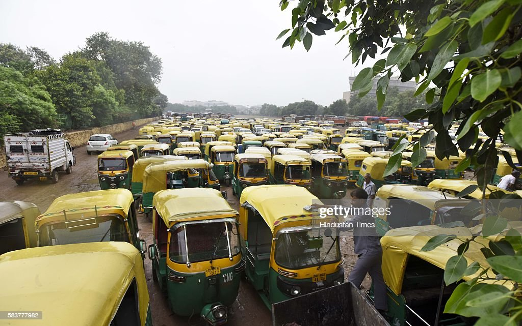 Parked auto rickshaws seen during the auto taxi strike at Ramlila Maidan on July 27 2016 in New Delhi India The capital's auto and taxi unions went...
