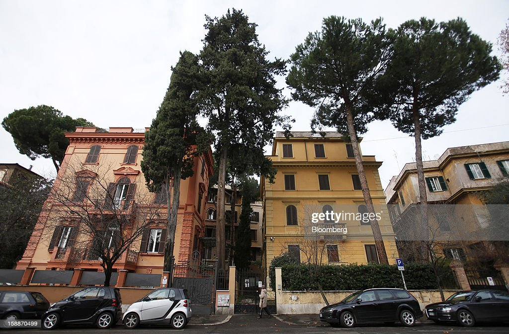 Parked automobiles stand on street near residential apartment blocks in the Coppede district of Rome, Italy, on Wednesday, Jan. 2, 2013. Italian property sales often are reported to be less than the actual price paid to reduce taxes or skirt controls on money laundering, according to the website of the finance police, which reports to Italian Finance Minister Vittorio Grilli. Photographer: Alessia Pierdomenico/Bloomberg via Getty Images