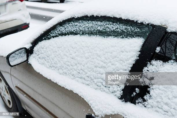 Parked Car Covered in Snow During Winter Montreal Canada