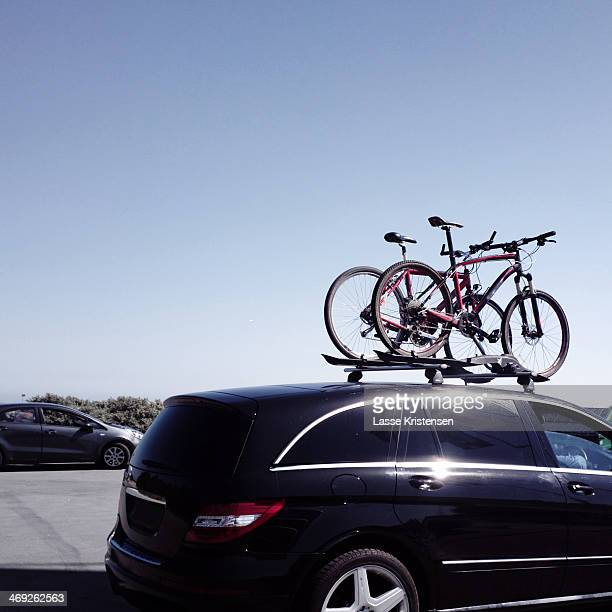 Parked car with bicycles on the roof