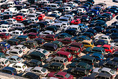 Parked cars at the busy Port of Savona, Italy.