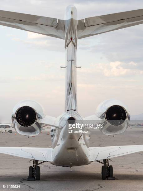 Parked executive jet on airfield