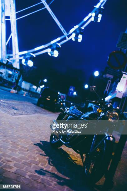 Parked motorcycle at night