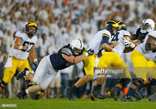 Parker Cothren of the Penn State Nittany Lions sacks John O'Korn of the Michigan Wolverines in the second half on October 21 2017 at Beaver Stadium...