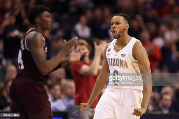 Parker JacksonCartwright of the Arizona Wildcats celebrates after scoring ahead of Robert Williams of the Texas AM Aggies during the second half of...