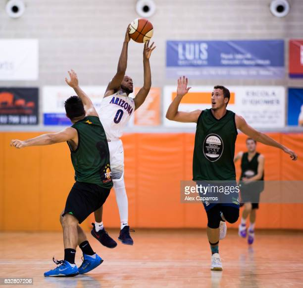 Parker JacksonCartwright of the Arizona Wildcats plays the ball between Alfons Oleart and Carles Homs of the Mataro AllStars during the Arizona In...