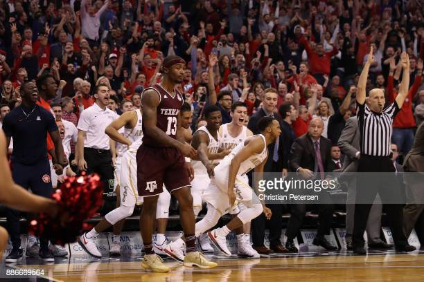 Parker JacksonCartwright of the Arizona Wildcats reacts after hitting a three point shot over Duane Wilson of the Texas AM Aggies during the second...