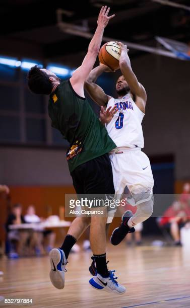 Parker JacksonCartwright of the Arizona Wildcats shoots over Sergi Costa of the Mataro AllStars during the Arizona In Espana Foreign Tour game...