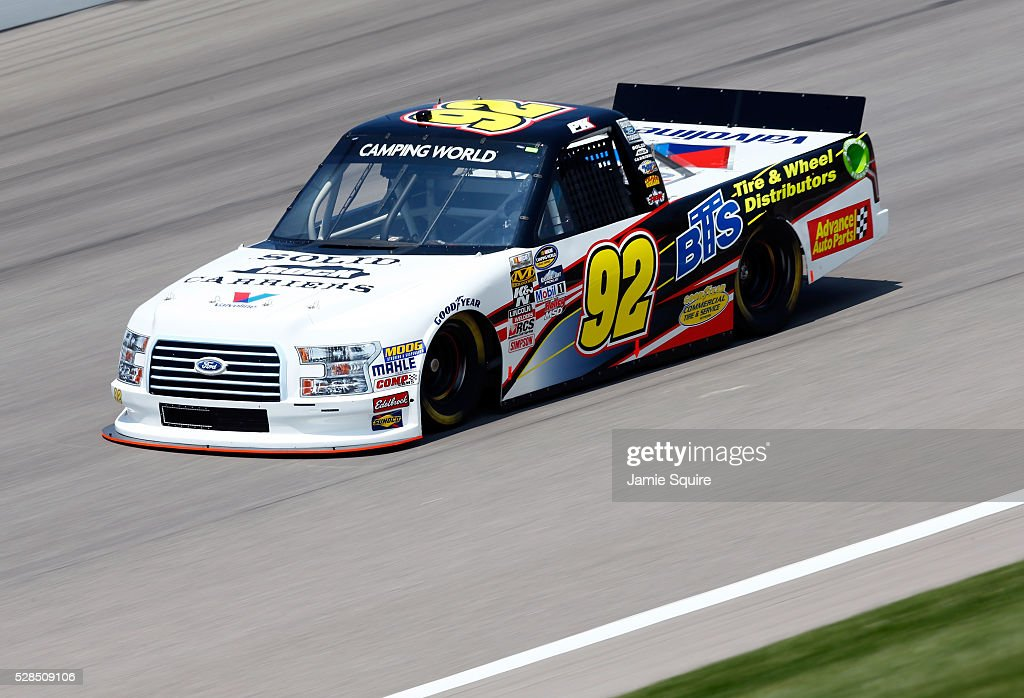 Parker Kligerman, driver of the #98 BTS Tire/SLD Rck Crrrs/Advance Auto Parts Ford, practices for the NASCAR Camping World Truck Series 16th Annual Toyota Tundra 250 on May 05, 2016 in Kansas City, Kansas.