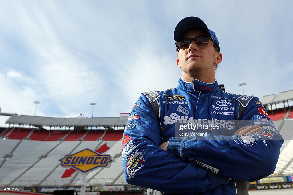 <a gi-track='captionPersonalityLinkClicked' href=/galleries/search?phrase=Parker+Kligerman&family=editorial&specificpeople=6348144 ng-click='$event.stopPropagation()'>Parker Kligerman</a>, driver of the #30 Swan Energy Toyota, stands on the grid during qualifying for the NASCAR Sprint Cup Series Food City 500 at Bristol Motor Speedway on March 14, 2014 in Bristol, Tennessee.