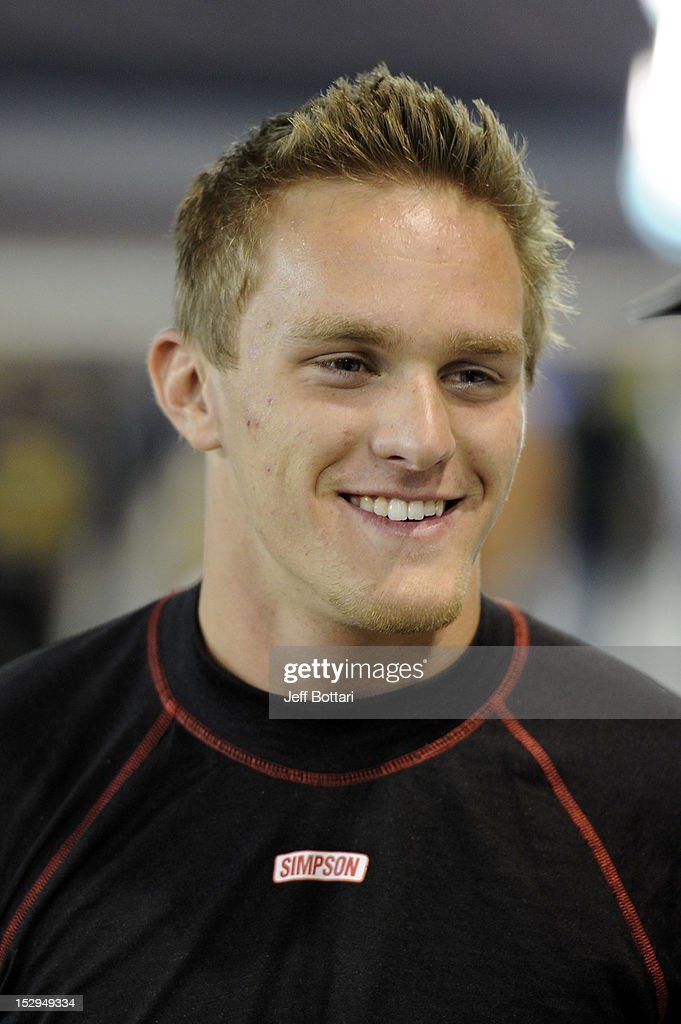 <a gi-track='captionPersonalityLinkClicked' href=/galleries/search?phrase=Parker+Kligerman&family=editorial&specificpeople=6348144 ng-click='$event.stopPropagation()'>Parker Kligerman</a>, driver of the #7 TOYOTA/Red Horse Racing Toyota, stands on the grid during qualifying for the NASCAR Camping World Truck Series Smith's 350 race at Las Vegas Motor Speedway on September 28, 2012 in Las Vegas, Nevada.