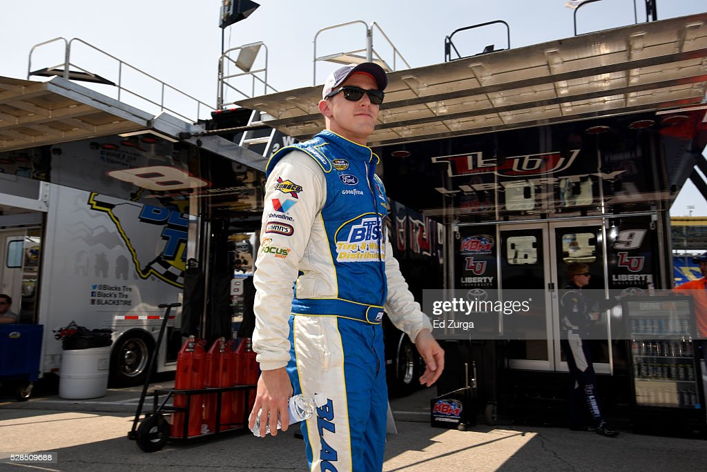 Parker Kligerman, driver of the #92, walks the garage area during a practice sessions for the Toyota Tundra 250 at Kansas Speedway on May 5, 2016 in Kansas City, Kansas.