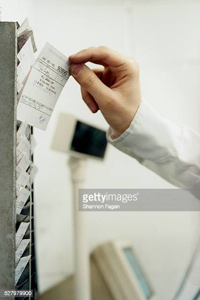 Parking Attendant Selecting Ticket