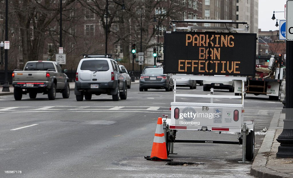 A 'Parking Ban Effective' sign is displayed on a road in Boston, Massachusetts, U.S., on Friday, Feb. 8, 2013. The New England cities are expected to receive more than 2 feet of snow by the time Winter Storm Nemo moves out tomorrow night, according to the weather service. Photographer: Kelvin Ma/Bloomberg via Getty Images