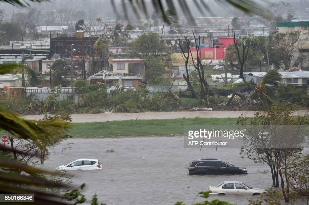 A parking lot is flooded near Roberto Clemente Coliseum in San Juan Puerto Rico on September 20 during Hurricane Maria Maria slammed into Puerto Rico...