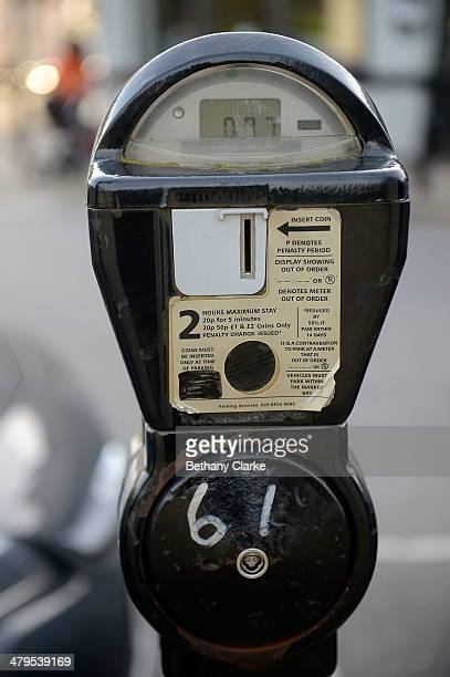 A parking meter accepts coins on March 19 2014 in London England Plans have been announced by the Bank of England to replace the current one pound...