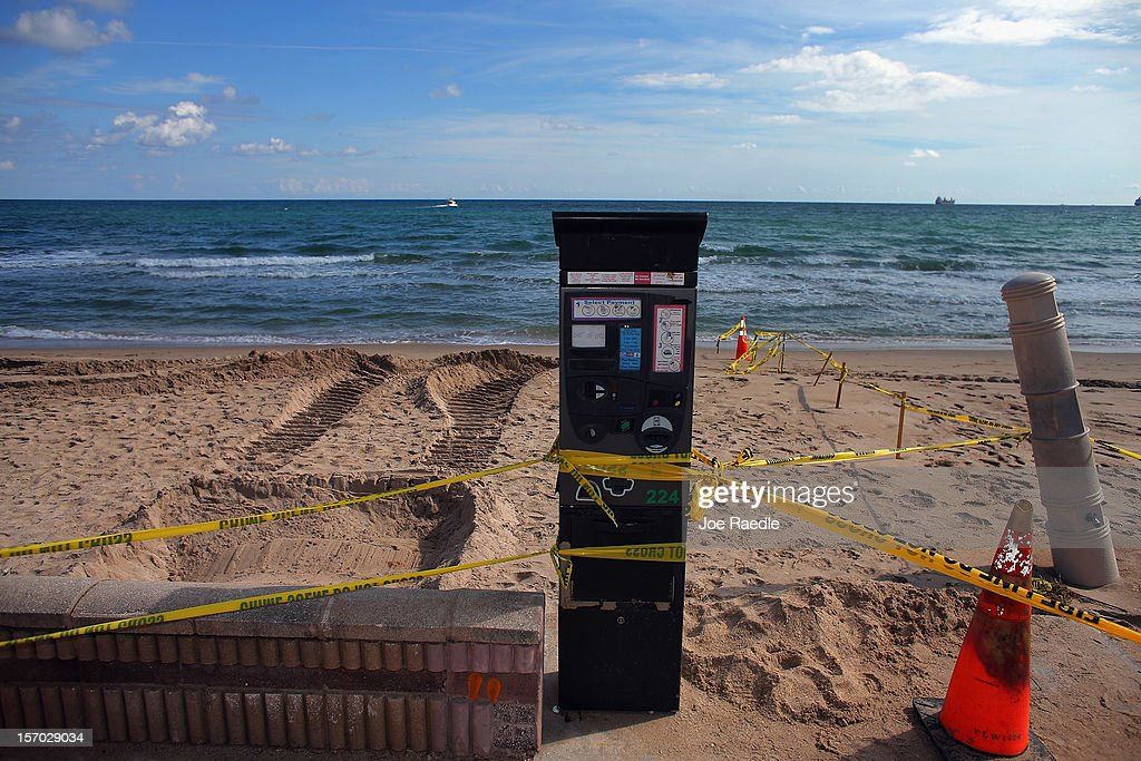 A parking meter is marked off due to damage caused by beach erosion along route A-1-A impassable to vehicles on November 27, 2012 in Fort Lauderdale, Florida. The beach was eroded away last month when Hurricane Sandy passed by to the east and now City officials are saying that the damage may preview what rising sea levels can mean for coastal communities throughout South Florida. Climate scientists predict sea levels in South Florida will rise by 1 foot by 2070, 2 feet by 2115, and 3 feet by 2150.