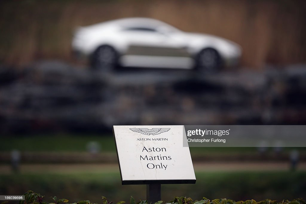 A parking sign for Aston Martin motor cars only sits outside the company headquarters and production plant on January 10, 2013 in Gaydon, England. The iconic British brand is celebrating its 100th anniversary. Lionel Martin and Robert Bamford created Bamford & Martin on January 15 1913, which later became Aston Martin in honour of Bamford's wins at the Aston Clinton Hillclimb in Buckinghamshire.