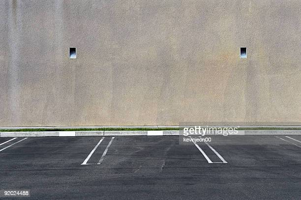Parking spots against a blank wall