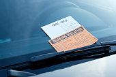 Parking violation ticket fine on the windshield