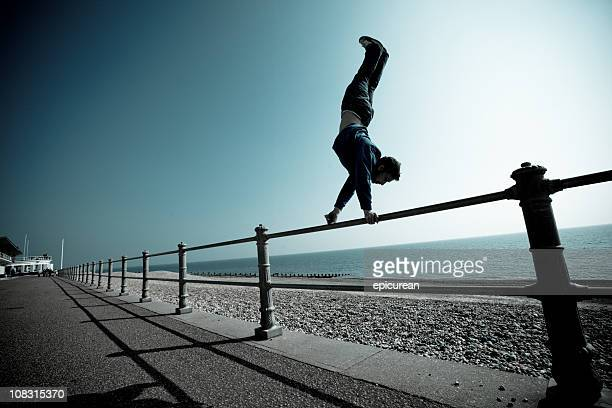 Parkour and freerunning rail handstand