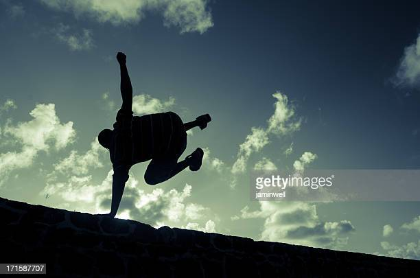 parkour practicing man silhouette