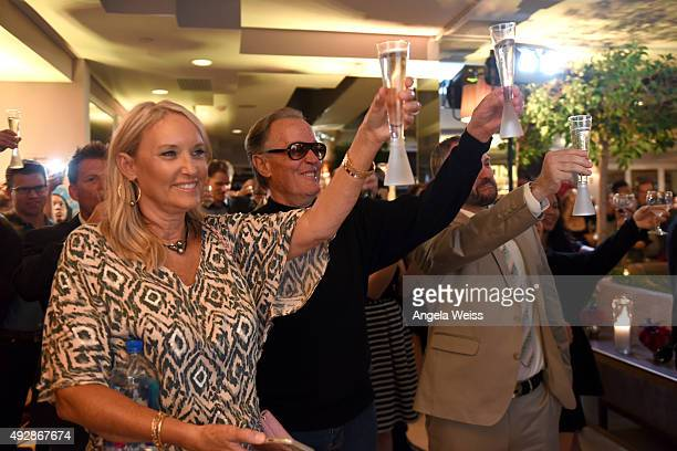 Parky Fonda and actor Peter Fonda raise champagne flutes in toast during IMDb's 25th Anniversary Party cohosted by Amazon Studios presented by VISINE...