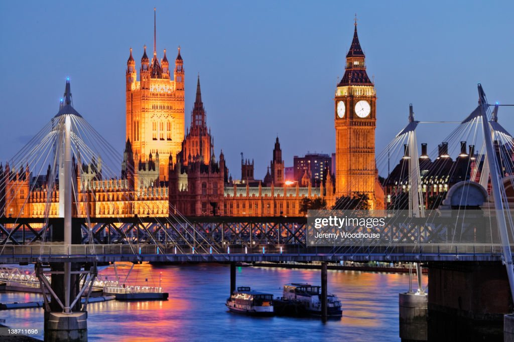 Parliament and Charing Cross bridge over river : Stock Photo