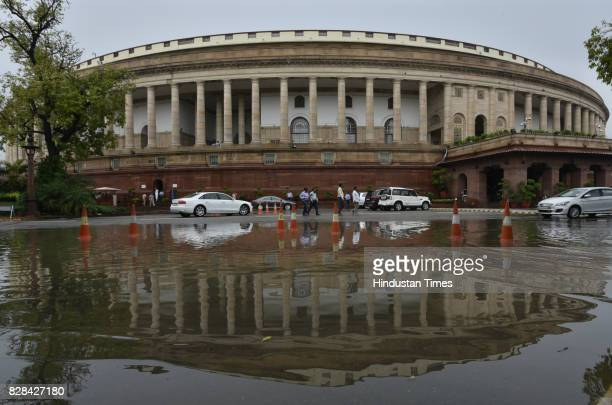 Parliament building reflection seen on a waterlogged water during the Monsoon Session on August 9 2017 in New Delhi India