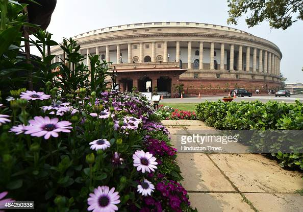 Parliament building seen the back drop of full bloom flowers during first Day of Budget Session on February 23 2015 in New Delhi India The budget...