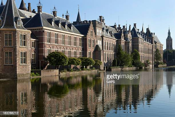 Parliament buildings in The Hague with sunny reflection