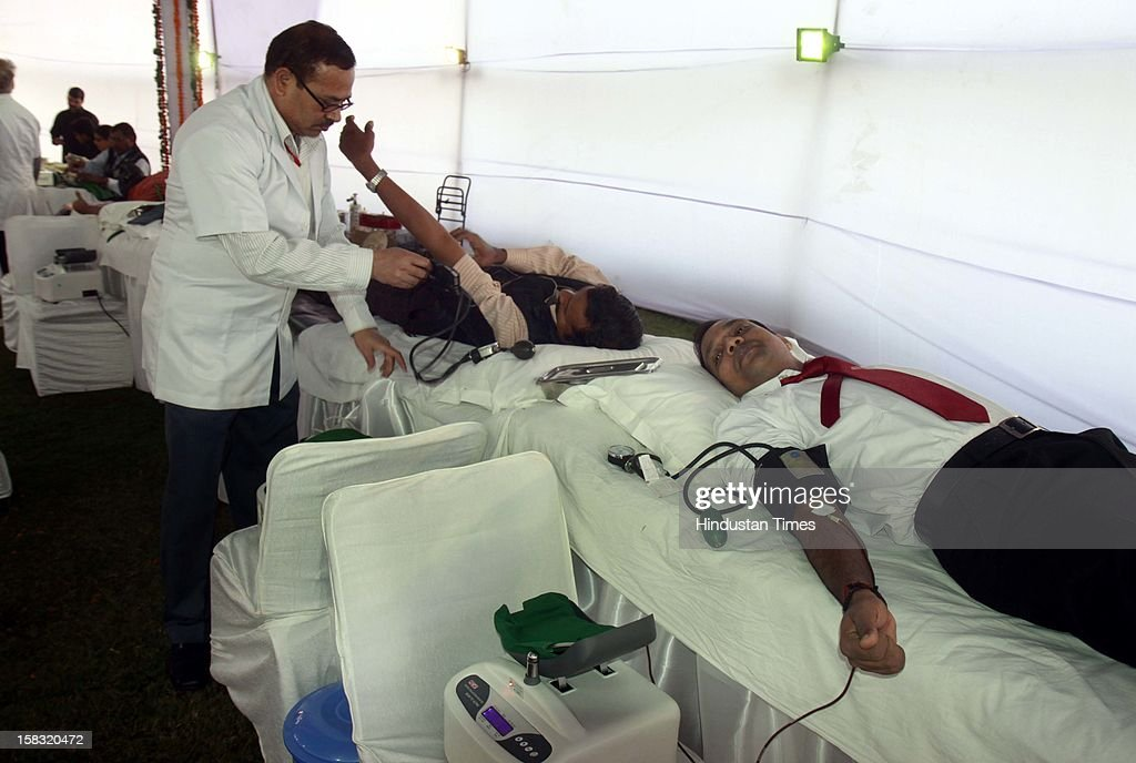 Parliament officers donate blood during remembrance ceremony of the 2001 Parliament attack, at Parliament House on December 13, 2012 in New Delhi, India. Politicans gathered to observe the eleventh anniversary of a bloody militant attack on the complex, which left 14 dead on December 13, 2001.