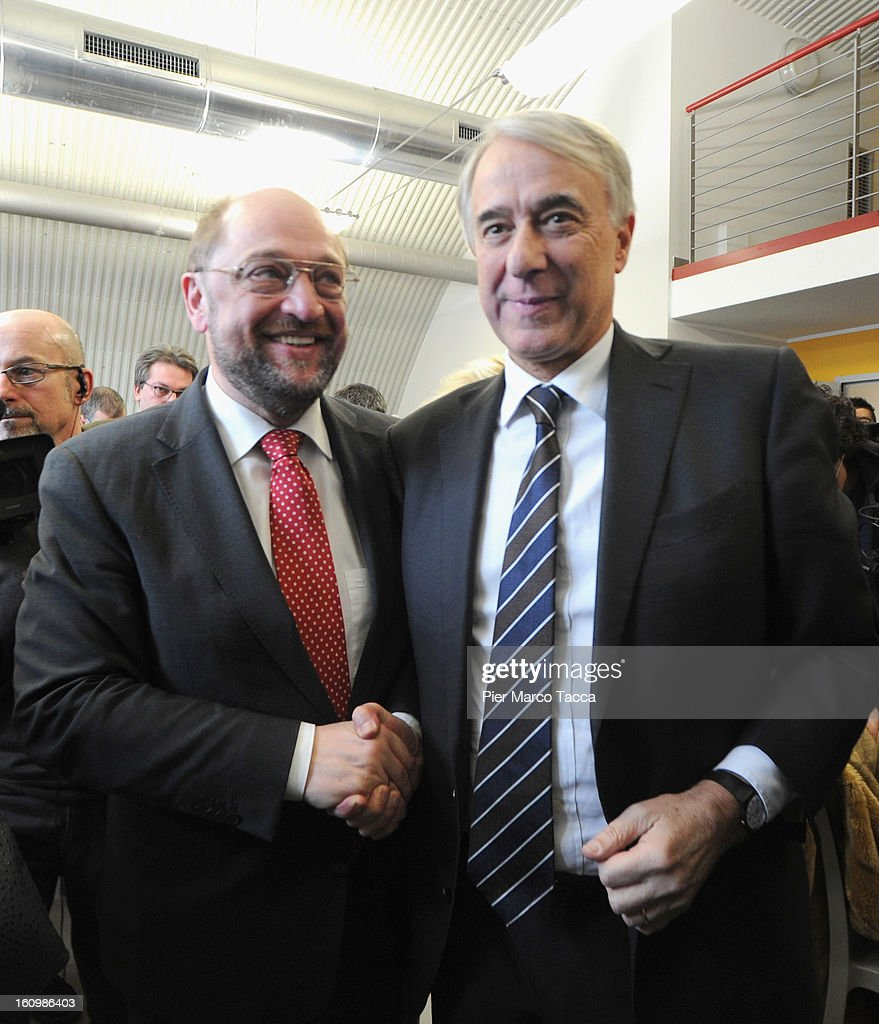 EU Parliament President Martin Schulz shakes the hand to Mayor Of Milan Giuliano Pisapia before the press conference before the visit to Caritas Ambrosiana shelter on February 8, 2013 in Milan, Italy. Caritas is a night refuge for the homeless and is situated under the platforms of the central station.