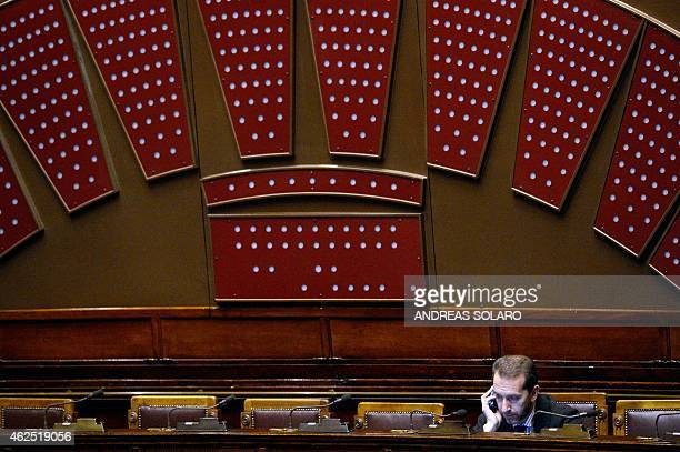 A parliamentarian makes a phone call in the Italian Parliament in Rome on January 30 at the end of a vote session during the second day of vote for...