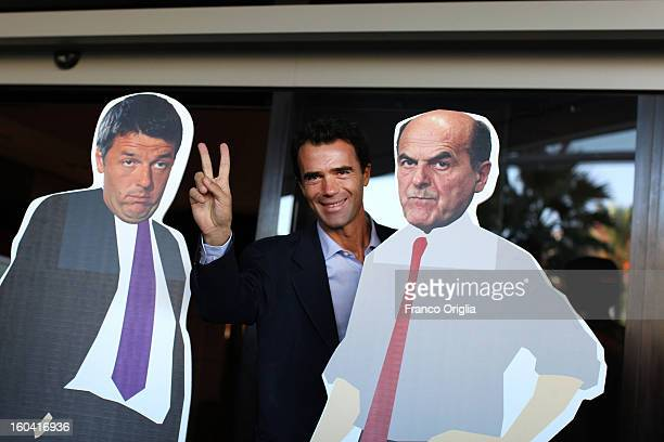Parliamentarian of the Democratic Party Sandro Gozi framed by a banner featuring PD secretary Pier Luigi Bersani and Matteo Renzi arrives at the...
