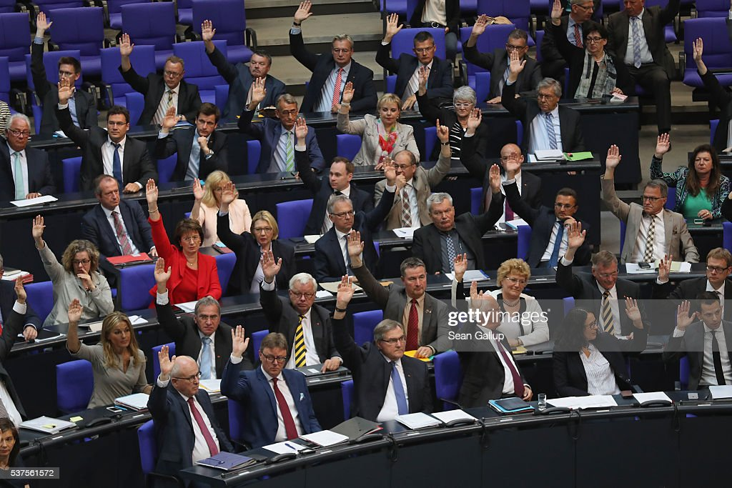 Parliamentarians approve with a show of hands a resolution to recognize the 1915 Armenian genocide on June 2, 2016 in Berlin, Germany. The Bundestag approved a resolution recognizing the 1915-1916 deaths of hundreds of thousands of Armenians and other ethnic groups at the hands of Ottoman Turkish forces. The Turkish government has opposed any labeling of the deaths as genocide and the approval will likely irritate German-Turkish relations.