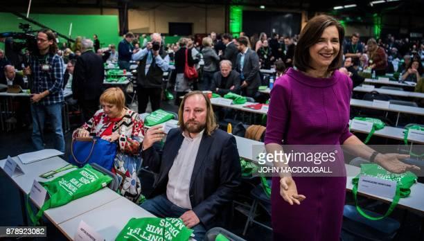 Parliamentary group coleader of the Green party Katrin GoeringEckardt gestures towards photographers as parliamentary group coleader of the Green...