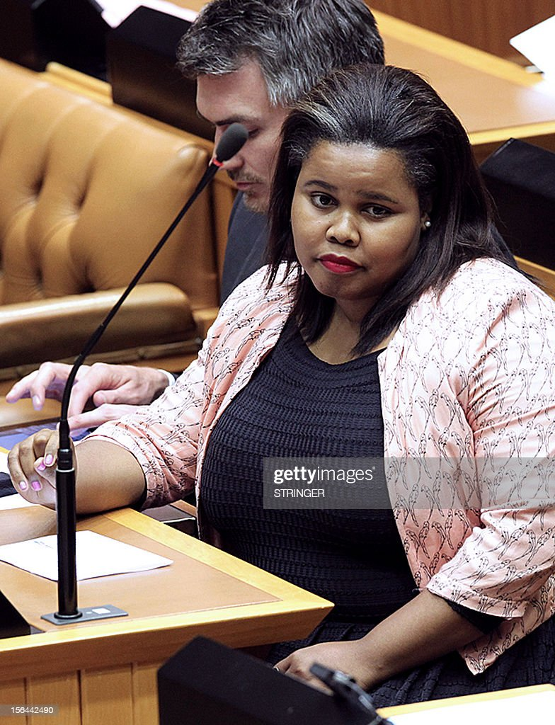Parliamentary leader for the opposition Democratic Alliance, Lindiwe Mazibuko, delivers a speech on November 15, 2012, in the parliament in Cape Town. Mazibuko spoke during a parliamentary session in which South Africa President Jacob Zuma hit back at accusations he is failing the country, hours after allies torpedoed attempts to censure him. Facing accusations he mismanaged the economy, was AWOL during deadly labour unrest and wasted millions of taxpayers' money on upgrading a private residence, a visibly angered Zuma struck back. It was a rare flash of steel for the normally jovial leader. In one month Zuma faces the ANC's electoral conference, which will go a long way toward deciding whether he remains president of Africa's largest economy for another five years. AFP PHOTO / STRINGER