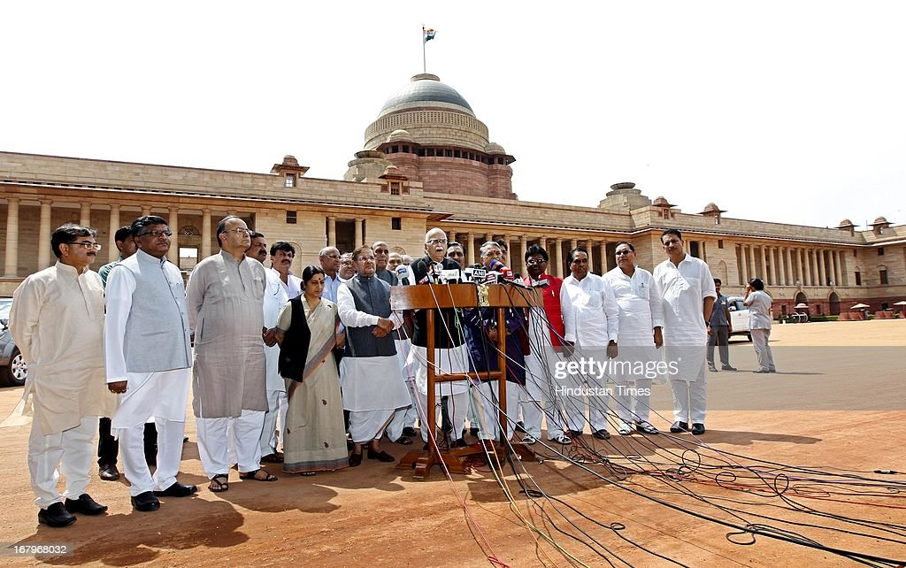 BJP Parliamentary Party Chief L K Advani, JD (U) Chief Sharad Yadav and BJP President Rajnath Singh talking to the media person after meeting with President Pranab Mukherjee at the forecourt of Rashtrapati Bhawan on May 3, 2013 in New Delhi, India. MPs of BJP-led NDA today met President Pranab Mukherjee to express concern over Chinese incursions into Ladakh and the manner in which the case of Indian prisoner Sarabjit Singh was handled by the government.
