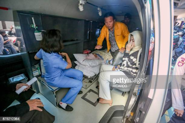 Parliamentary speaker Setya Novanto is accompanied by his spouse Deisti Astriani Tagor as he is transferred to another hospital in Jakarta on...