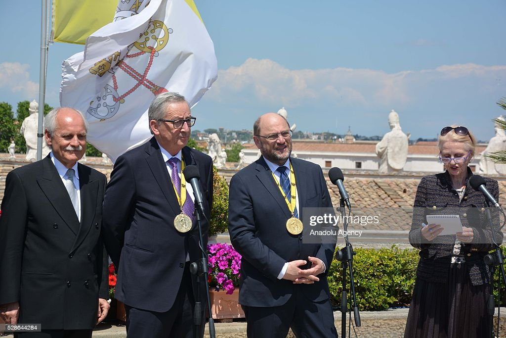 EU Parliament's speaker Martin Schulz (2nd R) and EU Commission president Jean-Claude Juncker () hold a press conference on the Charlemagne Prize 2016, in Vatican City on May 06, 2016. Pope Francois has been awarded the 2016 International Charlemagne Prize.
